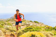 Happy trail running man in beautiful mountains Stock Image