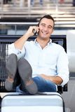 Happy travel man talking on cellphone at station. Portrait of happy travel man talking on cellphone at station royalty free stock photos