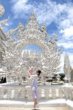 Happy travel mom with a child by Wat Rong Khun Stock Image