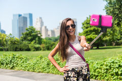 Happy travel tourist taking selfie stick picture stock photography