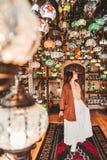 Happy travel woman choosing Amazing traditional handmade turkish lamps in Local souvenir shop ,Goreme. Cappadocia Turkey