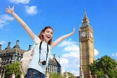 Happy travel woman in London. Happy woman travel in London with Big Ben tower, caucasian beauty Royalty Free Stock Photo