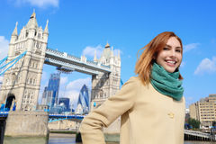 Happy travel woman. Happy woman travel in London with tower bridge, and smile to you, caucasian beauty Stock Photos