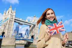 Happy travel woman. Happy woman travel in London with tower bridge, and smile to you, caucasian beauty Royalty Free Stock Photo