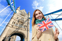 Happy travel woman. Happy woman travel in London with tower bridge, and smile to you, caucasian beauty Royalty Free Stock Image