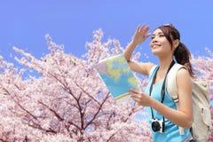 Happy travel woman with sakura tree Stock Photos