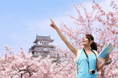Happy travel woman with sakura tree Royalty Free Stock Photography
