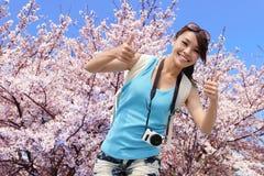 Happy travel woman with sakura tree Royalty Free Stock Images