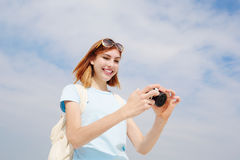 Happy travel woman use camera Stock Photos