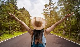 Happy travel woman on vacation concept. Funny traveler enjoy her trip and ready to adventure. stock photography