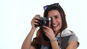 Happy travel young girl taking picture isolated over white background stock footage