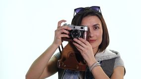 Happy travel young girl taking picture isolated over white background stock video footage