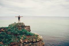 Happy traveler enjoying view of sea Stock Image