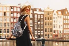 Happy traveler girl enjoying Amsterdam city. Smiling tourist woman, Amsterdam, Netherlands, Europe stock photos