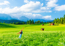 Happy traveler girl in mountainous valley Stock Photo