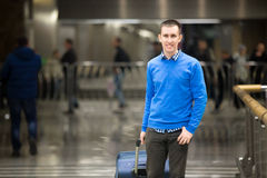 Happy traveler guy at airport Stock Photos