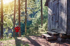 Happy traveler hiking to wooden house Stock Image
