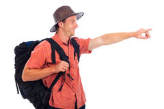 Happy traveler pointing the way Stock Photo