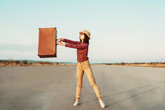 Happy traveler with suitcase Stock Photo