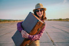 Happy traveler with suitcase Stock Photos