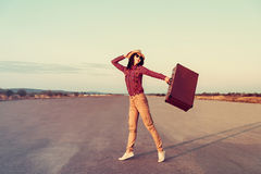 Happy traveler with suitcase Stock Photography