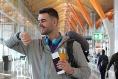 Happy traveler about to board royalty free stock photo