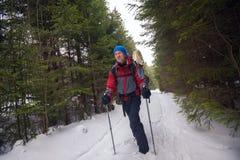 Happy traveler walks along a path Stock Photos