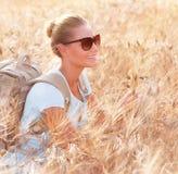 Happy traveler in wheat field Royalty Free Stock Photo