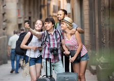 Happy travelers with luggage doing selfie Stock Image