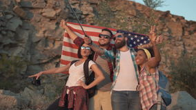 Happy travelers taking selfie with flag stock video