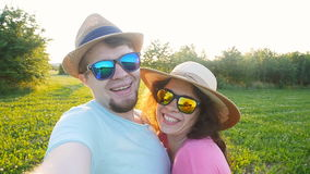 Happy traveling couple making selfie sunny summer colors at sunset. In sun glasses stock video footage