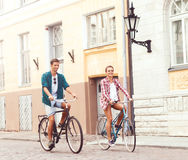 Happy traveling couple riding on bicycles. Boyfriend and girlfri Royalty Free Stock Image