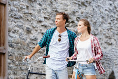 Happy traveling couple riding on bicycles. Boyfriend and girlfri Royalty Free Stock Photo