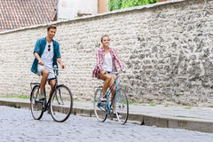 Happy traveling couple riding on bicycles. Boyfriend and girlfri Royalty Free Stock Photography