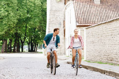 Happy traveling couple riding on bicycles. Stock Photo