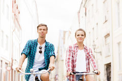 Happy traveling couple riding on bicycles. Stock Photos