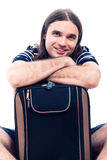 Happy traveller tourist man with luggage. Young happy smiling handsome traveller tourist man with luggage, isolated on white background Royalty Free Stock Photography