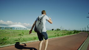 Happy traveller walking. At local path. Man listening to music and dancing stock video footage