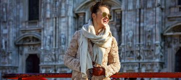 Happy traveller woman in Milan, Italy looking into distance Royalty Free Stock Photos