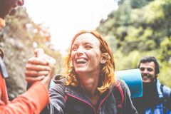 Free Happy Trekkers Helping Each Others Hiking On Mountaing Path - Real People Faces Having Fun On Trekking Day - Survival, Helping, Royalty Free Stock Photography - 170278397