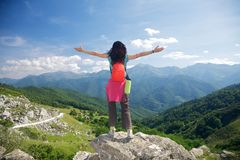 Happy trekking woman in Picos de Europa Royalty Free Stock Photos