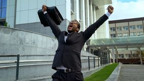 Happy with tremendous success businessman shouting outdoors, promotion success royalty free stock photos