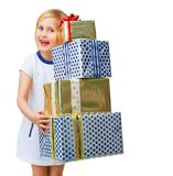 Happy trendy child on white holding pile of Christmas gifts. Modern Girl. happy trendy child in white dress isolated on white background holding pile of Stock Photography