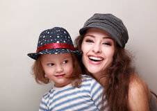 Happy trendy family in caps. Laughing mother and fun kid Stock Image