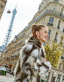 Happy trendy fashion-monger with Christmas tree in Paris, France Royalty Free Stock Photography