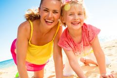 Happy trendy mother and child in colorful clothes on beach. Colorful and wonderfully cheerful mood. happy trendy mother and child in colorful clothes on the Stock Photos