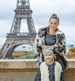 Happy trendy mother and child in Paris, France having fun time. The Party Season in Paris. Portrait of happy trendy mother and child in Paris, France having fun Stock Images