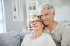 Happy trendy senior couple at their new home Royalty Free Stock Photography