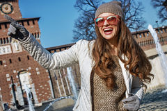 Happy trendy woman in Milan, Italy pointing on something Royalty Free Stock Photography