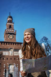 Happy trendy woman near Sforza Castle in Milan, Italy with map Royalty Free Stock Images